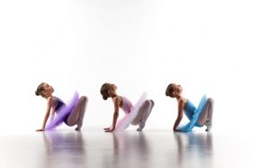 42949130 - silhouettes of three little ballet girls sitting in ballet pose in multicolored tutu and pointe shoes together on white background